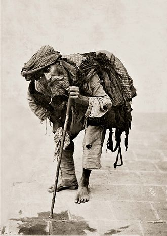 Begging - A beggar in 1880s Tehran, photographed by Antoin Sevruguin