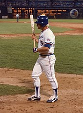 Wearing a blue helmet and white jersey of the Atlanta Braves, Bob Horner clutches his bat with both hands