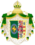 Coat of arms consisting of a shield with a green field with a golden armillary sphere over the red and white Cross of the Order of Christ, surrounded by a blue band with 20 silver stars; the bearers are two arms of a wreath, with a coffee branch on the left and a flowering tobacco branch on the right; and above the shield is an arched golden and jeweled crown