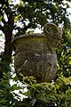 Bridge pan satyr urn in the Pleasure Grounds, Parham House, West Sussex, England.jpg