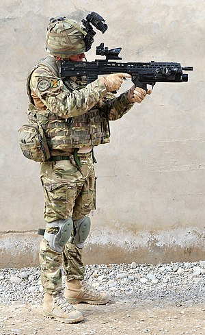 """British Army Soldier in Full Kit in Afghanistan"". The file page provides informative details about the soldier's outfit and gear, which increases the encyclopedic value of the photo."