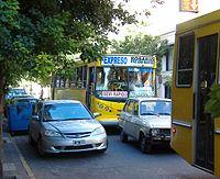 An express interurban bus in downtown Rosario.