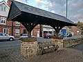 Bus stop in centre of Pleasley, Notts.jpg