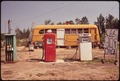 CUT-RATE GAS STATION OPERATES OUT OF BUS - NARA - 546153.tif