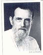 Black and white profile photograph of an old man in white beard and dark hair.