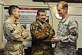 Canadian Brig. Gen. Paul Wynnyk and Italian Brig. Gen. Carmelo Burgio talk with Gen. Stanley McChrystal (4251232883).jpg