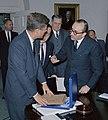 Carlos Manuel Muñiz presents a gift of a vicuña poncho to President Kennedy (cropped).jpg