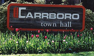 Carrboro, North Carolina - The Carrboro town hall sign, surrounded by tulips in April 2000
