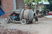 Child playing in a cement mixer