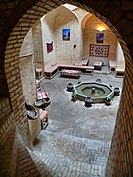 A Chaikhaneh (tea house) close to the Zendan-e Eskandar (Alexander the great's prison) at Yazd. Its location underground allows to spend some wonderful moments in a cool ambiance, refreshed by the flow of the water in the central pool.