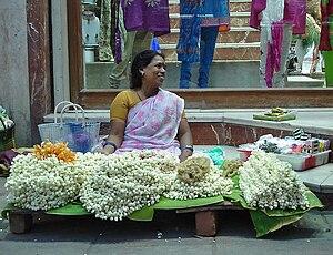 Jasmine in Karnataka - A street vendor sells jasmine garlands in Chennai, India