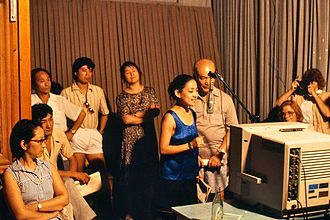 Voice acting - Actors dubbing a television show in China while visitors look on, 1987