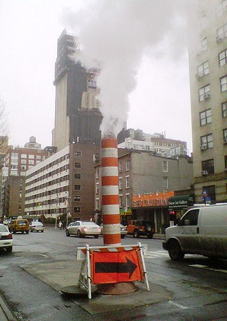 New York City steam system - Image: Con Ed steam stack 7th Ave and 20th Street from north