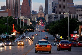 Congress Avenue Historic District - Downtown Austin and the State Capitol as seen from Congress Avenue.
