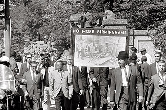 "Congress of Racial Equality - Congress of Racial Equality march in Washington DC on 22 September 1963 in memory of the children killed in the Birmingham bombings. The banner, which says ""No more Birminghams"", shows a picture of the aftermath of the bombing."