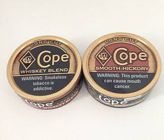 Copenhagen (tobacco) - A can of Cope Whiskey Blend and Cope Smooth Hickory