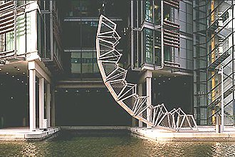 Paddington Waterside - The Rolling Bridge in Paddington Basin curls up to let boats through.