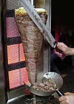 Shawarma being sliced before serving