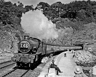 Torbay Express - Ex-GWR 'Castle' 4-6-0 No. 5079 Lysander heads the down Torbay Express out of Parson's Tunnel at Dawlish