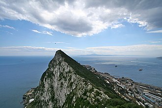 Pillars of Hercules - The European Pillar of Hercules: the Rock of Gibraltar (foreground), with the North African shore in the background.