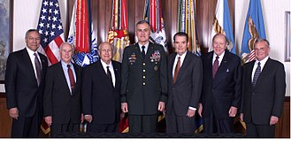 Chairman of the Joint Chiefs of Staff - General Henry H. Shelton hosted on 1 December 2000 a conference in the Pentagon for former Chairmen of the Joint Chiefs of Staff. Standing from left to right are: Gen. Colin L. Powell, USA (Ret); Gen. John W. Vessey, USA (Ret); Adm. Thomas H. Moorer, USN (Ret); Gen. Shelton, USA; Gen. David C. Jones, USAF (Ret); Adm. William J. Crowe, Jr., USN (Ret); and Gen. John M. Shalikashvili, USA (Ret).