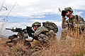 Defense.gov News Photo 101104-A-7125B-053 - U.S. Army Spc. Joshua D. Heinbuch left and Spc. James M. Piccolo right secure the area after finding an improvised explosive device on a road in.jpg
