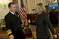 Defense.gov News Photo 110202-N-0696M-016 - Chairman of the Joint Chiefs of Staff Adm. Mike Mullen U.S. Navy speaks with Secretary of State Hillary Clinton prior to delivering remarks at.jpg