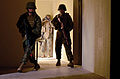 Defense.gov News Photo 110308-M-JG138-006 - Marines with Military Police Company secure a building and begin to process the scene by photographing and recording the rooms during a forensic.jpg
