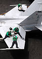 Defense.gov News Photo 110621-N-QL471-078 - Sailors assigned to Strike Fighter Squadron 15 perform maintenance on an F A-18C Hornet aboard the aircraft carrier USS George H.W. Bush CVN 77 in.jpg