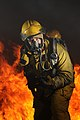 Defense.gov News Photo 110708-N-WP746-073 - U.S. Navy Petty Officer 1st Class Hector Floresdiaz demonstrates firefighting techniques to students attending the Center for Naval Engineering.jpg