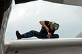 Defense.gov News Photo 110906-N-ZN240-030 - U.S. Navy Petty Officer 2nd Class Ruel Beck applies sealant to a leading edge wing panel of a P-3C Orion on Kadena Air Base in Okinawa Japan on.jpg