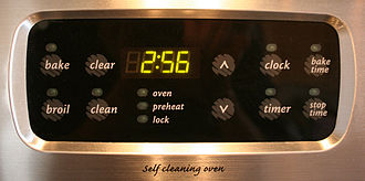 Digital clock - This digital clock has been attached to an oven.