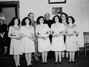 Dionne quintuplets -  The quintuplets in 1947 with their parents and a priest in the background