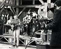1962 B&W photograph of Donn Reynolds performing on the set of Cross Canada Barndance (Winnipeg, Manitoba, Canada).