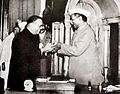 Dr. Babasaheb Ambedkar, chairman of the Drafting Committee, presenting the final draft of the Indian Constitution to Dr. Rajendra Prasad on 25 November, 1949.jpg