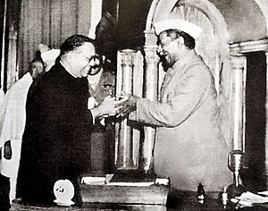 Constituent Assembly of India - Image: Dr. Babasaheb Ambedkar, chairman of the Drafting Committee, presenting the final draft of the Indian Constitution to Dr. Rajendra Prasad on 25 November, 1949