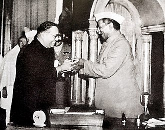 Constitution of India - Babasaheb Ambedkar, chairman of the drafting committee, presenting the final draft of the Indian constitution to Constituent Assembly president Rajendra Prasad on 25 November 1949