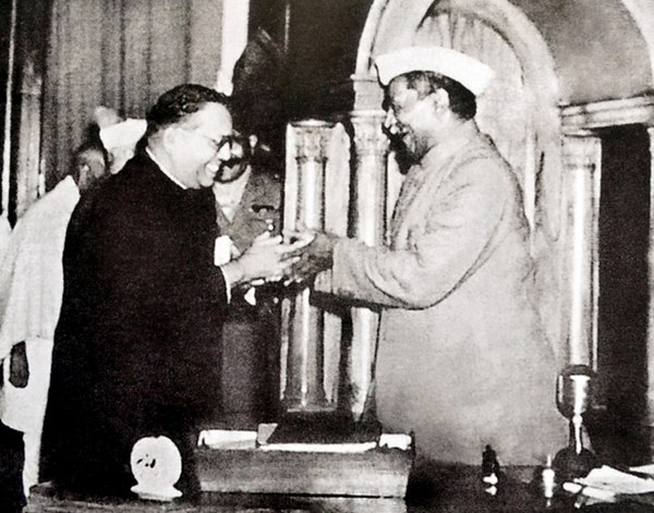 Ambedkar, chairman of the Drafting Committee, presenting the final draft of the Indian Constitution to Rajendra Prasad on 25 November 1949 Dr. Babasaheb Ambedkar, chairman of the Drafting Committee, presenting the final draft of the Indian Constitution to Dr. Rajendra Prasad on 25 November, 1949.jpg