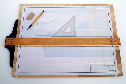 Drafting board with a T-square and triangle