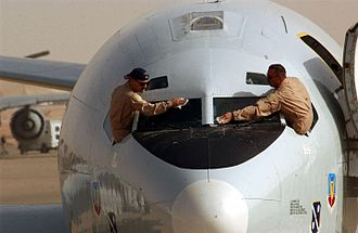 Northrop Grumman E-8 Joint STARS - Pilots from Robins Air Force Base cleaning the windshields of their E-8 before a mission in Iraq