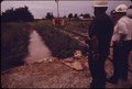 EPA AUTHORITIES SUPERVISE A HASTILY CONSTRUCTED HOLDING POND CONTAINING WATER TREATED FOR REMOVAL OF CHROMIUM. A... - NARA - 555563.tif