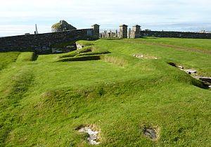 Orphir Round Church - The Earl's Bu, with the church behind
