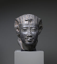 This granite statue depicts Ptolemy II in the traditional canon of ancient Egyptian art. Walters Art Museum, Baltimore.