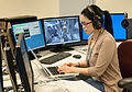 Estrellina Pacis on console as science lead in the Multi-Mission Operations Center.jpg
