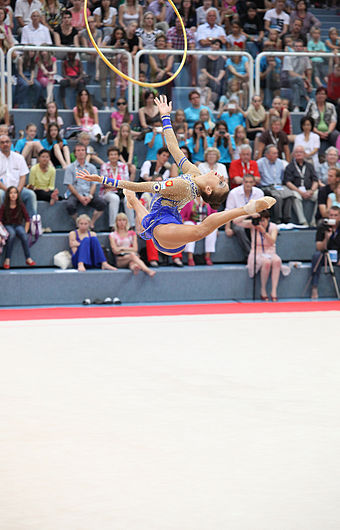 Evgenia Kanaeva doing a Split leap in her hoop routine Evgenia Kanaeva 2012 in Hard.JPG