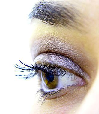 Eye shadow - An eye with heavy purple eye shadow