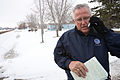 FEMA - 40548 - A FEMA Public Information Officer on a cell phone in North Dakota.jpg