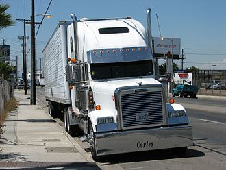 Trucking industry in the United States - The satellite communications link (a white dome-shaped plastic shell) can be seen on top of the truck cab.