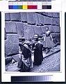 Fashion model following women down a street in Peru 3g04321v.jpg