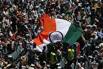 India national cricket team - Supporters of the Indian cricket team wave the Indian flag during match between India and Australia at the Melbourne Cricket Ground.